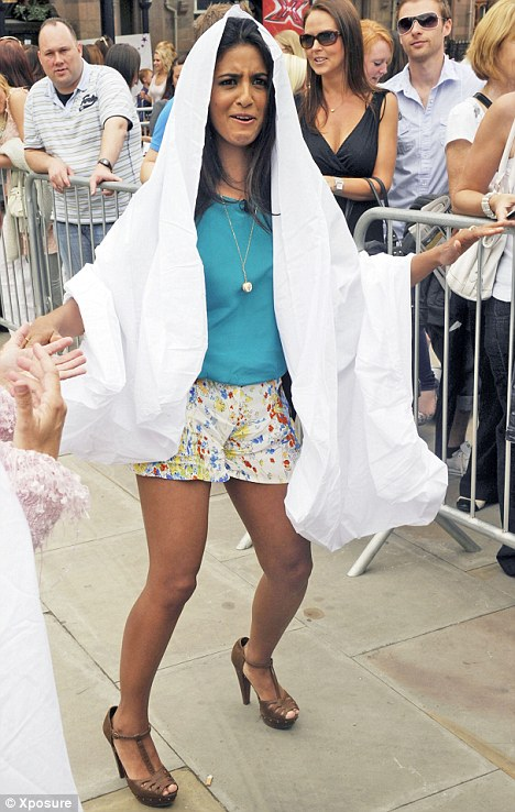 Too hot to handle: Huq draped a white sheet over her head as she entertained X Factor hopefuls in Manchester