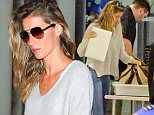 Please contact X17 before any use of these exclusive photos - x17@x17agency.com   Gisele Bundchen is spotted arriving at LAX airport solo for an outgoing flight. The supermodel and mother of two shows off her natural beauty in neutral tones and jeans. July 11, 2015/X17online.com