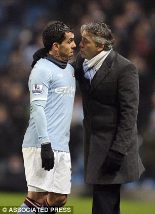 Bad blood? City manager Mancini and Tevez had a touchline bust-up during last weekends win over Bolton
