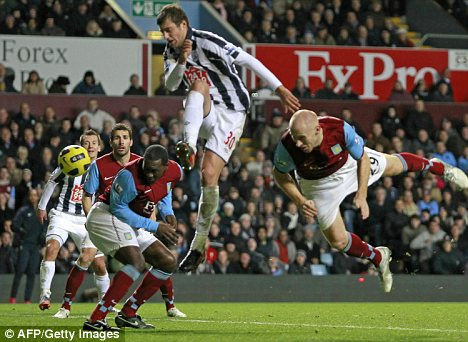 Emile Heskey stoops to direct a header past West Brom keeper Scott Carson