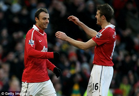 Nice one, son: Berbatov is congratulated after scoring one of his five goals against Blackburn last month