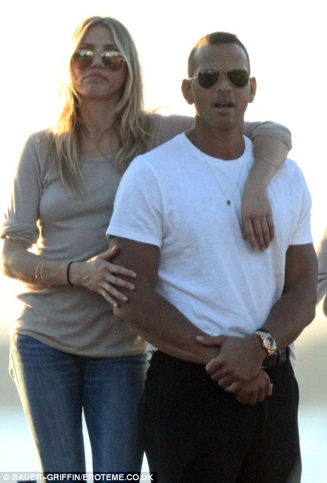 Relaxed: Cameron just can't keep her hands off A-Rod as she strokes his arm with one hand and wraps her other arm over his shoulder