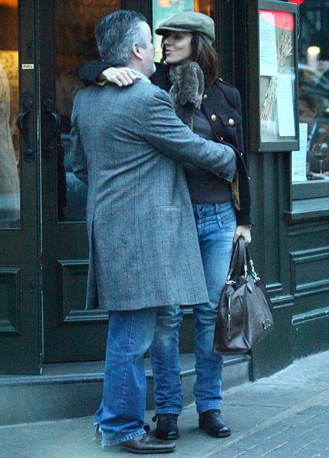 Just capital: Julia Bradbury shares a farewell kiss with her mystery man after their romantic lunch in London