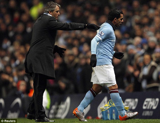 Crunch talks: Roberto Mancini plans to meet Carlos Tevez on Friday in his attempt to stop the striker walking out on Manchester City