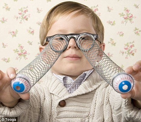 Boy wearing silly glasses with eyeballs