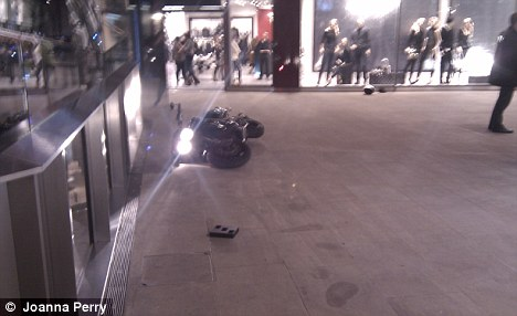 Evidence: A motorbike used by the raiders lies at the scene