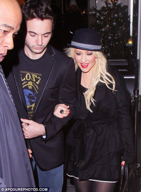 Party girl: Christina Aguilera heads out on the town with Matthew Rutler for the second time in three nights