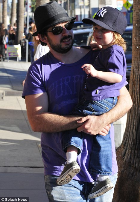 Good outfit dad: Max wears a purple t-shirt and jeans like his dad Jordan Bratman