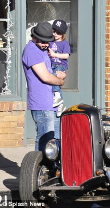 Fun day out: The pair inspect a vintage car and spent the day shopping together
