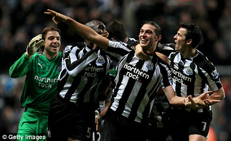 Good start: Newcastle celebrated a 3-1 win over Liverpool in new manager Alan Pardew's first game in charge at St James' Park