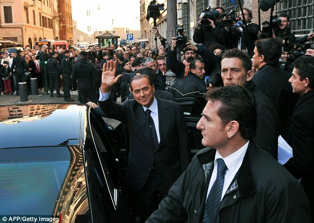 Job done? Silvio Berlusconi leaves the senate after warning that ousting him would be 'political folly'