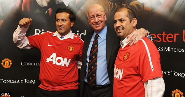 All smiles: Raul Bustos (left) and Mario Sepulveda will be among the guests of honour at Old Trafford