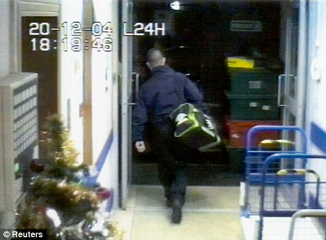 A CCTV image shows a member of staff at the headquarters of the Northern Bank in Belfast leaving the bank with a bag containing money on December 20, 2005