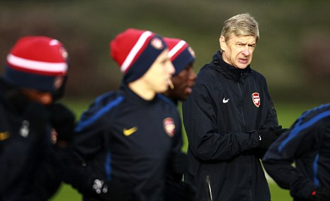 In charge: Wenger has called on his side to deliver in Monday night's crunch match