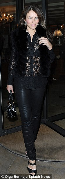 Just good friends?: Liz Hurley, left, pictured here leaving C Restaurant in London last Tuesday, was said to have spent Tuesday and Wednesday night with Shane Warne, right