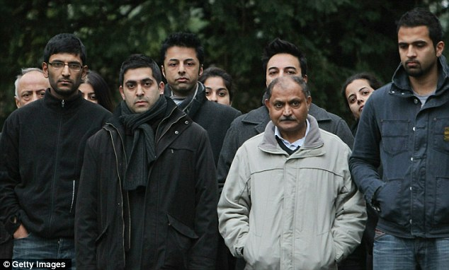 Family affair: Relatives of Shrien Dewani, third from left, offer their support outside the family's home in Bristol