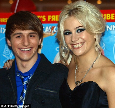 Firm friends: The pop star and her co-star Lucas Cruikshank were all smiles for the cameras at a special screening of Fred: The Movie