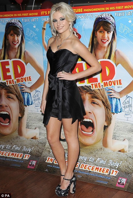 A Lotta leg: Pixie gets an A for red carpet dressing in a black Dolce and Gabbana dress at the premiere of her first film