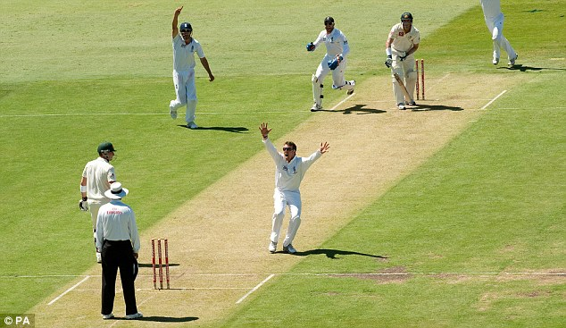 Delight: Graeme Swann successfully appeals for the crucial wicket of Mike Hussey