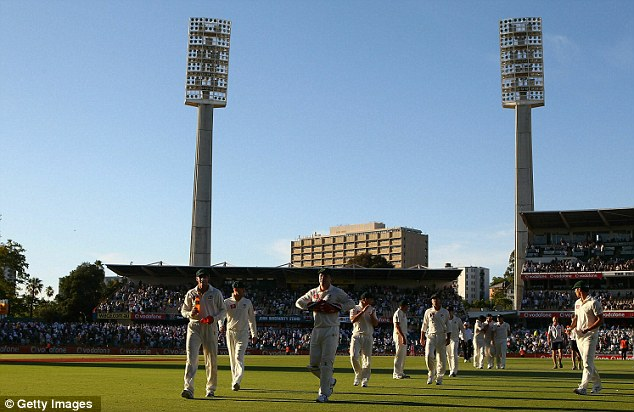Tough times: The Australians walk off at the end of day one at the WACA