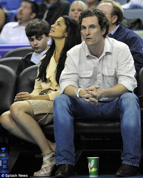 Try to look normal! Matthew and Camila's cold body language says it all