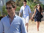 Eddie Redmayne plus wife puff him only.jpg
