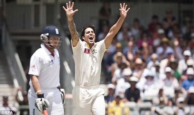 Danger man: Johnson celebrates yet another wicket as he tore through England's top order