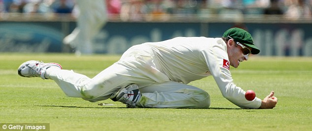 Misfield: Hussey allows the ball to scoot through his grasp and race for four
