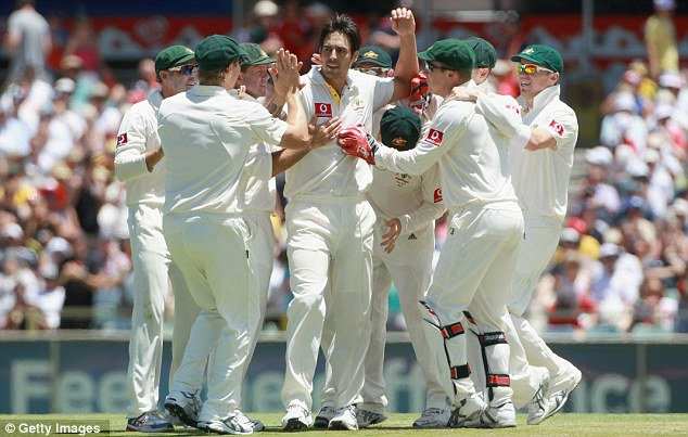 Triple trouble Mitchell Johnson is mobbed after taking his third wicket of the day