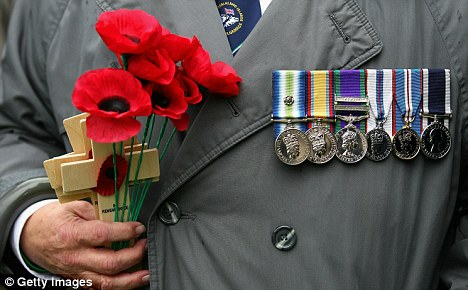 Overseas war veterans are prepared to hand back their medals in a row over frozen pernsions