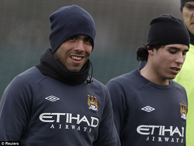 In the spotlight: Carlos Tevez with new signing Gai Assulin during training on Wednesday