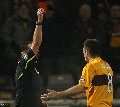 Red alert: Bookies are investigating irregular activity for bets placed on a red card during Motherwell's defeat to Hearts. Steve Jennings was sent off by referee Stevie O'Reilly