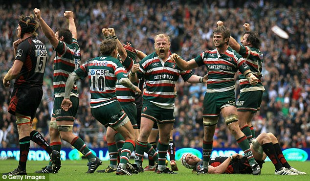 We've done it: Leicester players celebrate victory at Twickenham