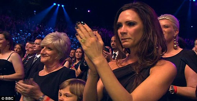 Teary: David's wife Victoria was reduced to tears when David took to the stage to collect his prize