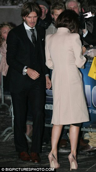 Arrivals: David and Victoria greet the crowds outside the ceremony in Birmingham