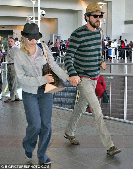 Still friends: Scarlett Johansson and actor Ryan Reynolds, who are divorcing [file picture]