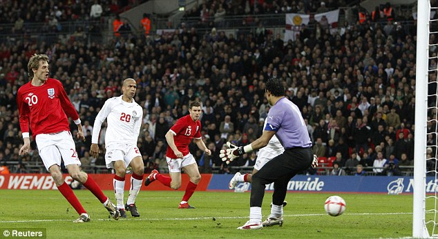 Eye for goal: Peter Crouch scores his second as England beat Egypt at Wembley