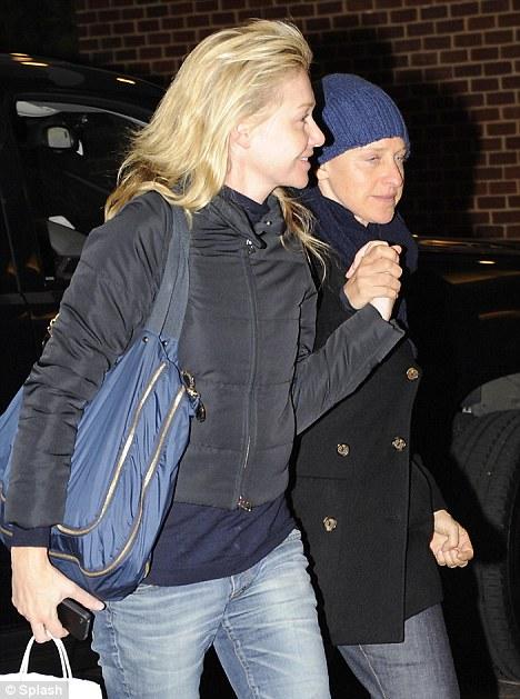 At last: Ellen DeGeneres right, with wife Portia De Rossi