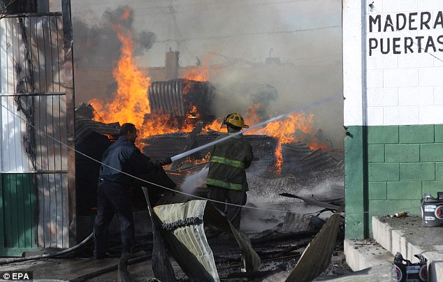 Investigation: Armed men poured petrol on the lumber factor in Ciudad Juarez before torching the building