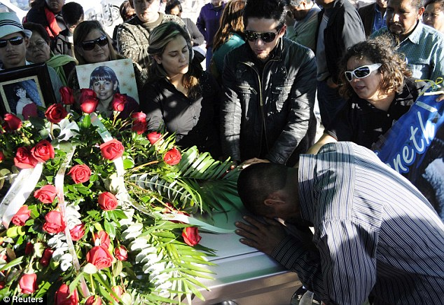 Inspiration: Relatives and friends pay their respects to Marisela Escobedo during her funeral at Panteon Cemetery