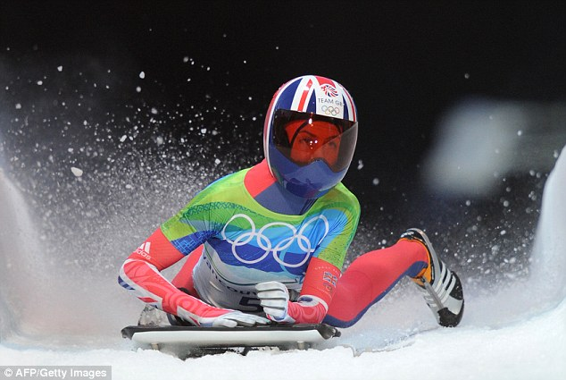 Golden girl: Amy Williams finishes the final heat to win gold in the women's Skeleton final at Whistler