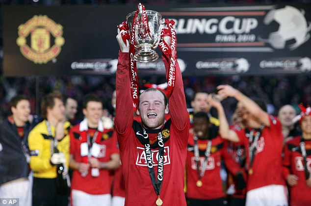 And still they're winning pots: Manchester United star Wayne Rooney with the Carling Cup