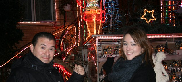 Julia admires the lights with Tony the guide