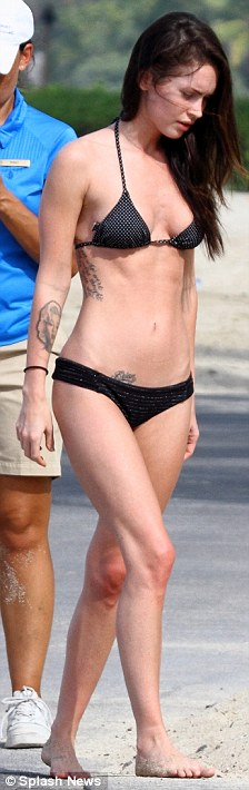 Wasting away: Megan's ribcage and hip bones were clear to see as she walked to the beach