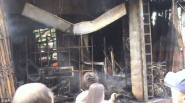 Gutted: Fifteen people were killed after a massive fire at the Bed and Breakfast Pension House in Tuguegarao city, Philippines