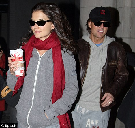 The couple that spin together: Tom Cruise and Katie Holmes attended a spin class in New York last night ahead of her birthday dinner