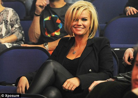 Suffering: Kerry Katona, seen at a Peter Andre concert earlier this week, is said to have cracked two ribs during Dancing On Ice rehearsals