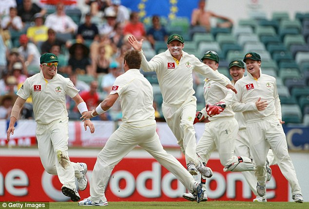 Another one bites the dust: Australia rush to celebrate with bowler Ryan Harris (second left) and catcher Mike Hussey (centre) after the pair combined to take the wicket of Matt Prior