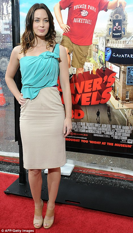 Regal! Emily Blunt looks pretty and poised wearing turquoise and taupe at the Gulliver's Travels premier today in Hollywood
