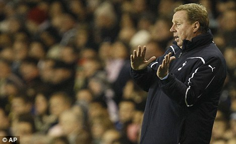 Happy Harry: Redknapp has been linked with the England after Fabio Capello